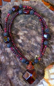 Garnet with lava stone and ebony wood